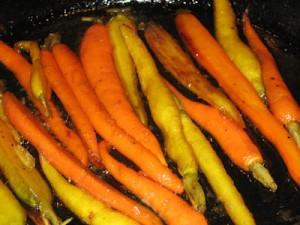 carrots sizzling away in some butter and olive oil with maple syrup
